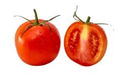 Tomat och en skiva av tomaten Arkivbilder