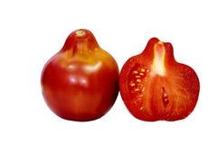 Tomat som isoleras på vit bakgrund med den snabba banan Closeup med inga skuggor Makro En tomat och halva en tomat Royaltyfri Bild