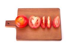 Tomat som isoleras på vitbakgrund Arkivbild