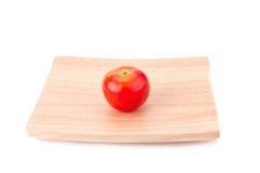 Tomat som isoleras på vitbakgrund Arkivfoton