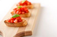 Tomatbruschettacrostini arkivfoton