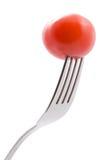 Tomate auf der Gabel getrennt Lizenzfreies Stockbild