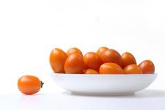 Tomate auf der Platte Lizenzfreies Stockbild