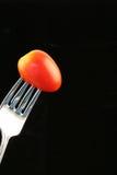 Tomate auf einer Gabel Stockfotos