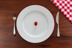 Tomate auf einer Platte Lizenzfreies Stockbild