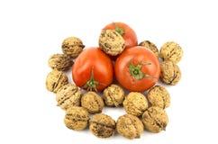 Tomate avec des noix Image libre de droits