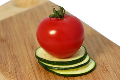 Tomate avec la courgette Images stock