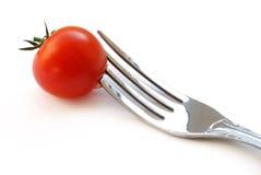 Tomate avec la fourchette Photographie stock libre de droits