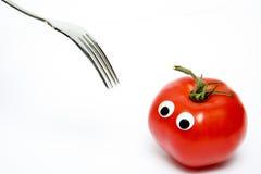 Tomate avec les yeux et la fourchette Photos libres de droits