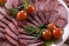 Tomate, carne fumado e salsichas fumado Imagens de Stock