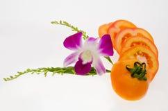 Tomate com orquídea Foto de Stock Royalty Free