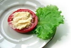 Tomate com sause no espinafre Imagens de Stock