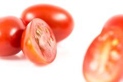Tomate de cereja no branco foto de stock