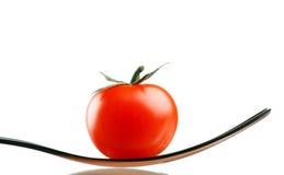 Tomate de cereza en fork Imagen de archivo