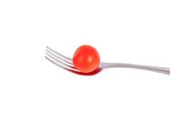 Tomate de cereza en una fork Fotografía de archivo