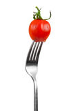 Tomate de cereza en una fork Imagenes de archivo