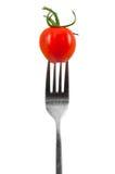 Tomate de cereza en una fork Imágenes de archivo libres de regalías