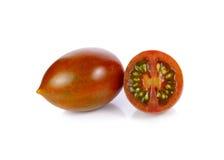 Tomate del color del tomate o de Brown del chocolate en el fondo blanco imagen de archivo libre de regalías