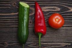Tomate del pepino y paprikas rojos Imagen de archivo libre de regalías