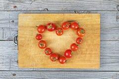 Tomate do alimento da ideia do coração do amor Fotografia de Stock Royalty Free