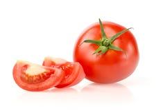 Tomate e fatias Imagem de Stock