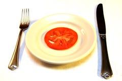 Tomate e prato imagem de stock