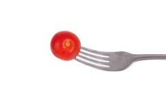 Tomate en fork Imagen de archivo
