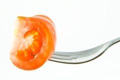 Tomate en una fork Imagenes de archivo