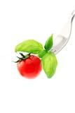 Tomate en una fork Imagen de archivo