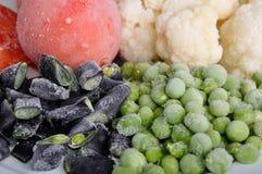 Tomate, espárrago, guisantes y coliflor congelados Foto de archivo