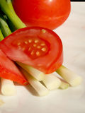 Tomate et ciboulette Photos libres de droits