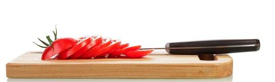 Tomate et couteau coupés Images libres de droits