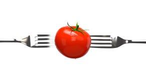 Tomate et deux fourchettes Images libres de droits