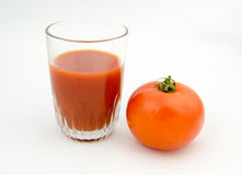 Tomate et jus Images stock