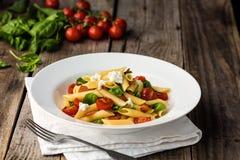 Tomate et lard Penne Pasta images libres de droits