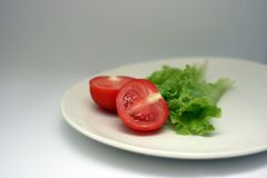Tomate et salade Images stock