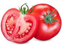Tomate et une moitié d'isolement sur un fond blanc Images libres de droits