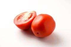 Tomate fraîche de coupe sur le fond blanc Images libres de droits