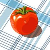 Tomate fresco en mantel de la tela escocesa stock de ilustración