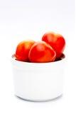 Tomate grande no copo branco Fotografia de Stock Royalty Free