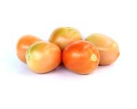 Tomate im Studio auf Weiß Stockfotografie
