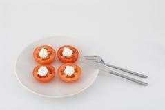 Tomate na placa Foto de Stock