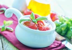 Tomate no molho Imagem de Stock Royalty Free