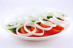 Tomate, pepino y cebolla Fotografía de archivo