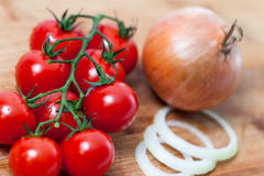 Tomate. Red vegetables. Rain-dripped red fresh tomatoes over red. Onion Royalty Free Stock Images