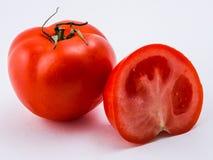 Tomate rouge sur un fond blanc Image stock