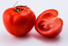 Tomate rouge sur un fond blanc Images stock