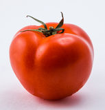 Tomate rouge sur un fond blanc Photos stock