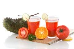 Tomate, sauer Sobbe und orange Mischungssaft Lizenzfreies Stockfoto