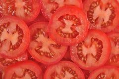 Tomate schneidet Hintergrund stockfotos